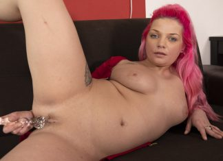 Busty Chick With Pink Hair Pleasuring Herself On The Couch